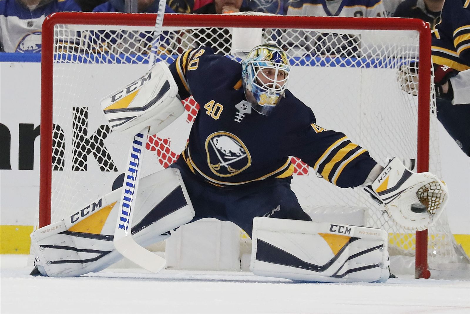 The Buffalo Sabres' Carter Hutton makes a save in the first period at KeyBank Center in Buffalo on Wednesday, Dece. 13, 2018.