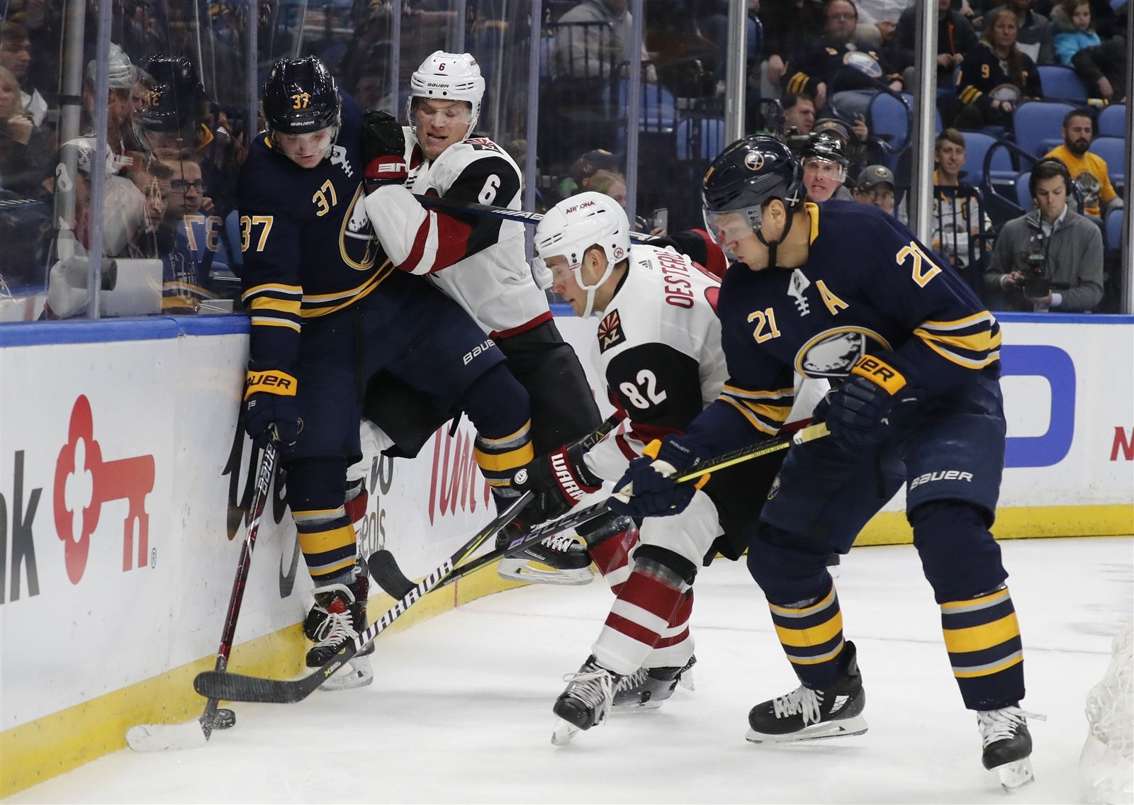 Buffalo Sabres Casey Mittelstadt gets checked by Arizona Coyotes Jacob Chychrun in the first period.