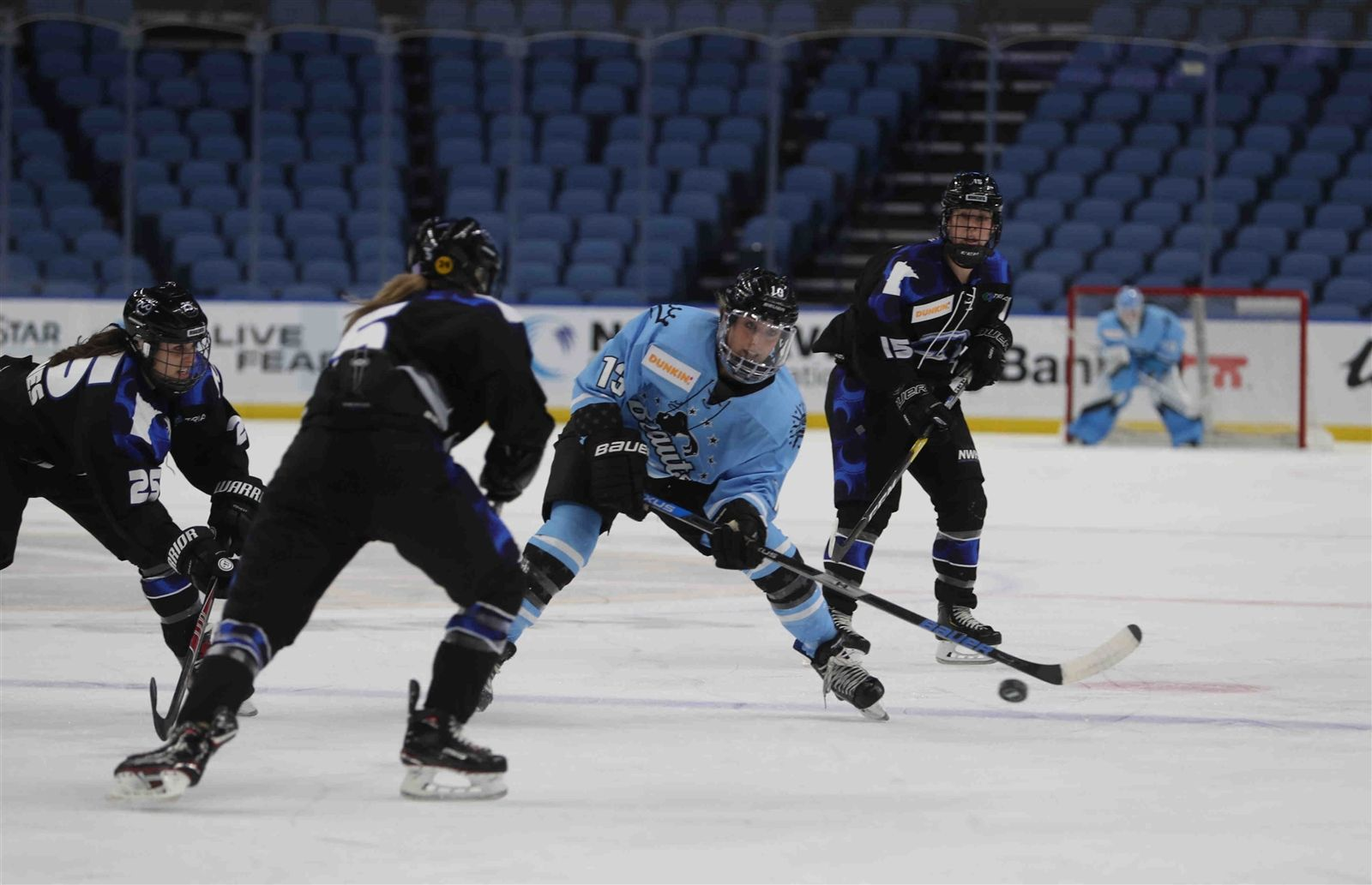 Buffalo's Annika Zalewski (13) goes for a loose puck with Minnesota Whitecaps Winny Brodt Brown (5).