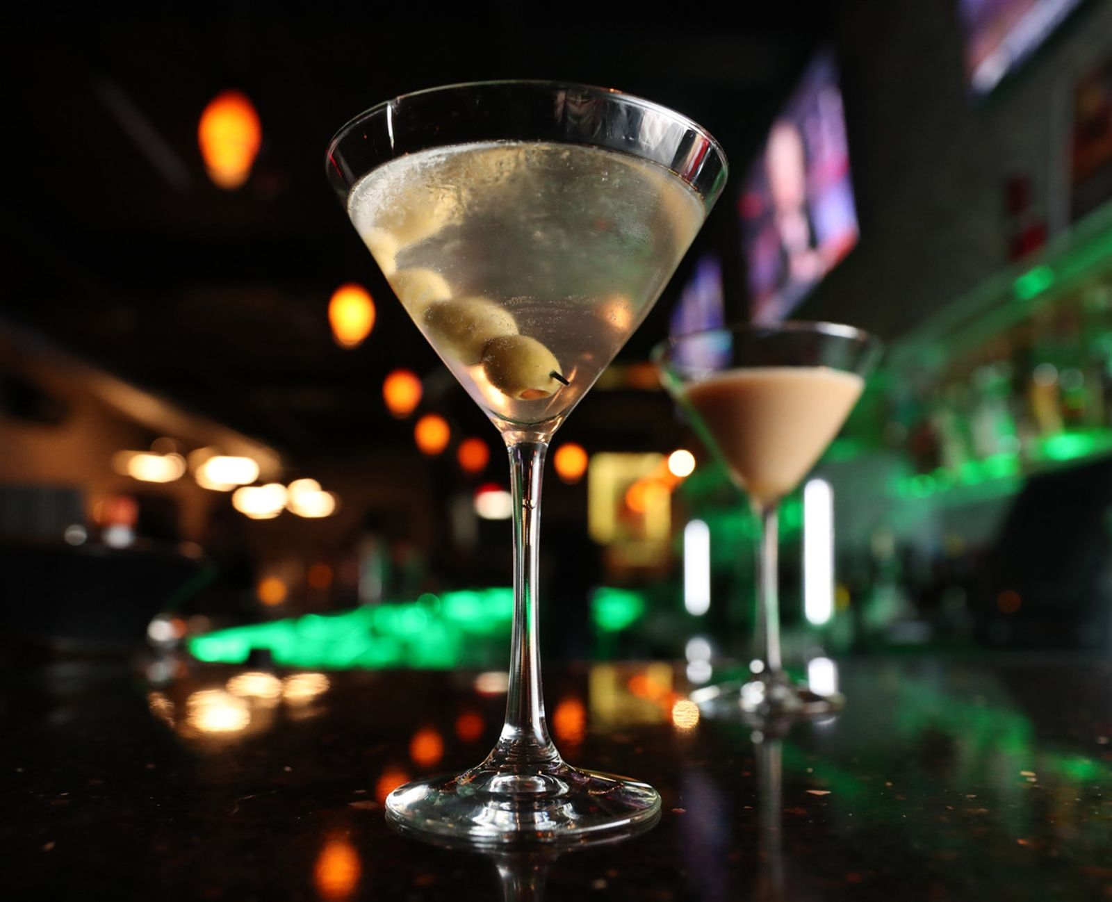 This is the Dirty D-Tour martini with vodka, dry vermouth and olive brine. Behind is The Exchange martini.