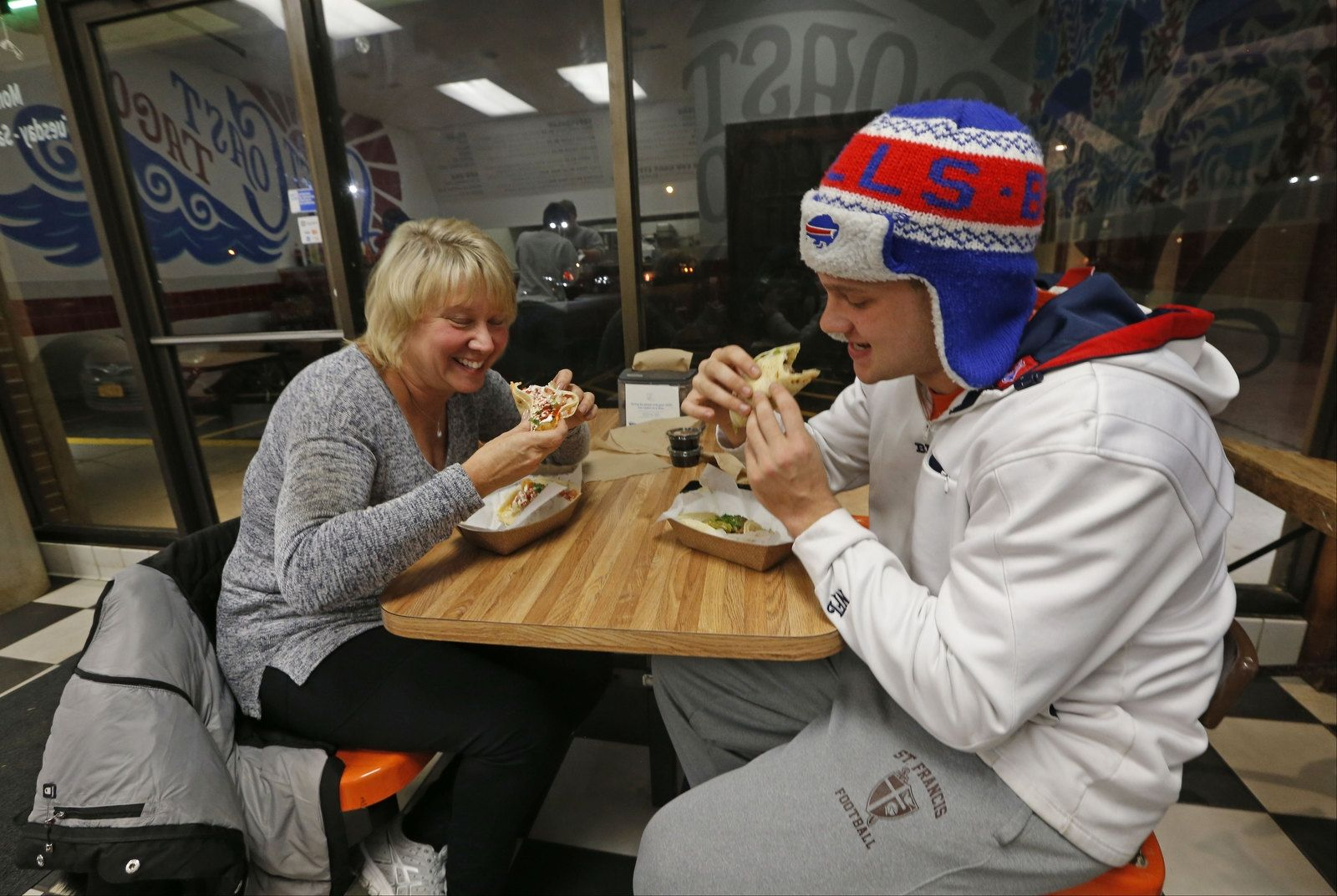 Customers Jerry Hickson, right, and his mother Pam enjoy tacos at Left Coast Taco.