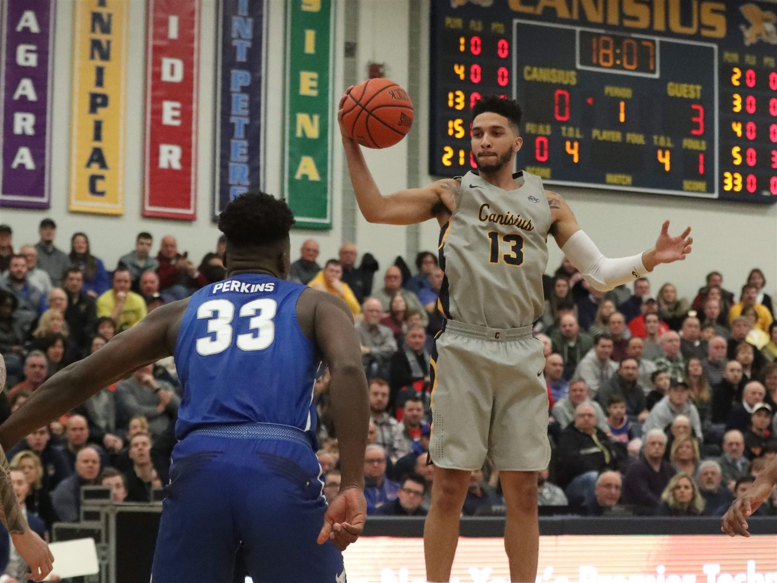Canisius Golden Griffins guard Isaiah Reese rebounds the ball in the first half.