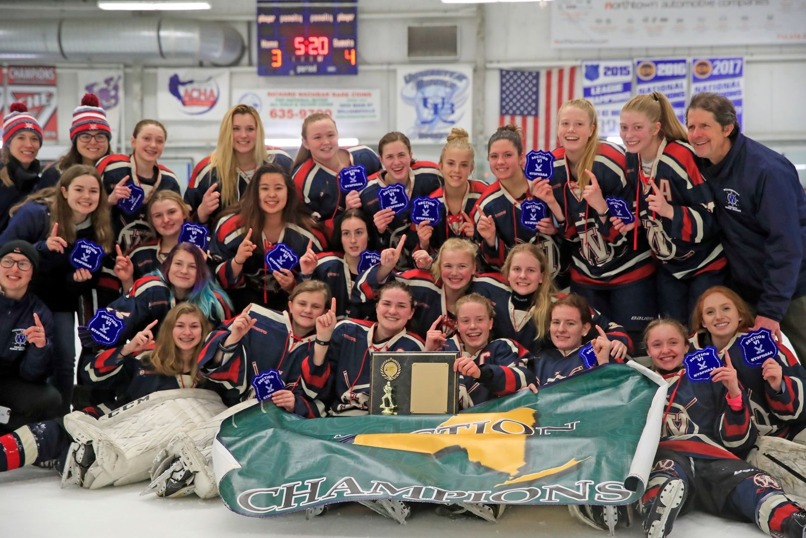 Williamsville celebrates a 4-3 overtime victory over Frontier/Lake Shore/Orchard Park (FLOP) for the Section VI girls ice hockey championship at the Northtown Center on Wednesday, Feb. 6, 2019.