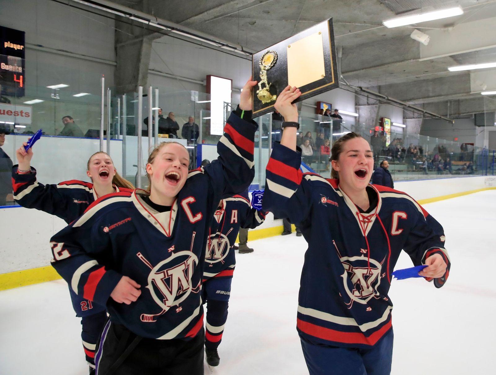 Williamsville captains celebrate.