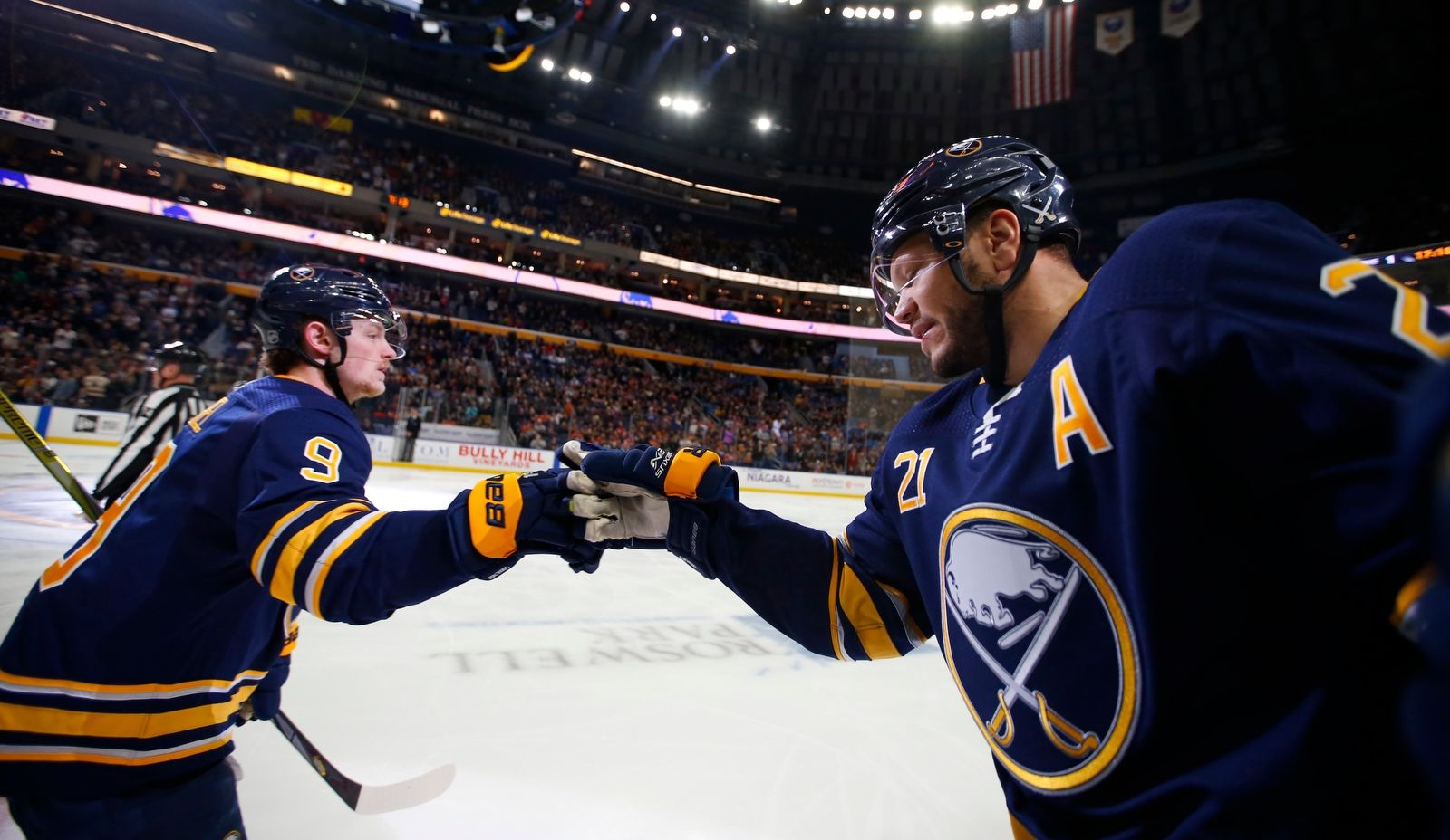 Sabres' Jack Eichel is congratulated on his goal by Kyle Okposo during the first period.