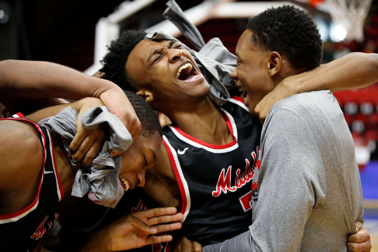 Middle Early College player Keith Brown celebrates a victory over Lake George in the New York State Class C semifinal at the Floyd L. Maines Veterans Memorial Arena in Binghamton on Saturday, March 16, 2019.