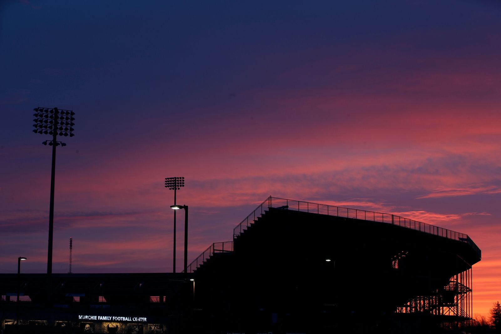 The sun rises on UB Stadium prior to Buffalo holding practice at the Murchie Family Fieldhouse on Thursday, March 28, 2019.