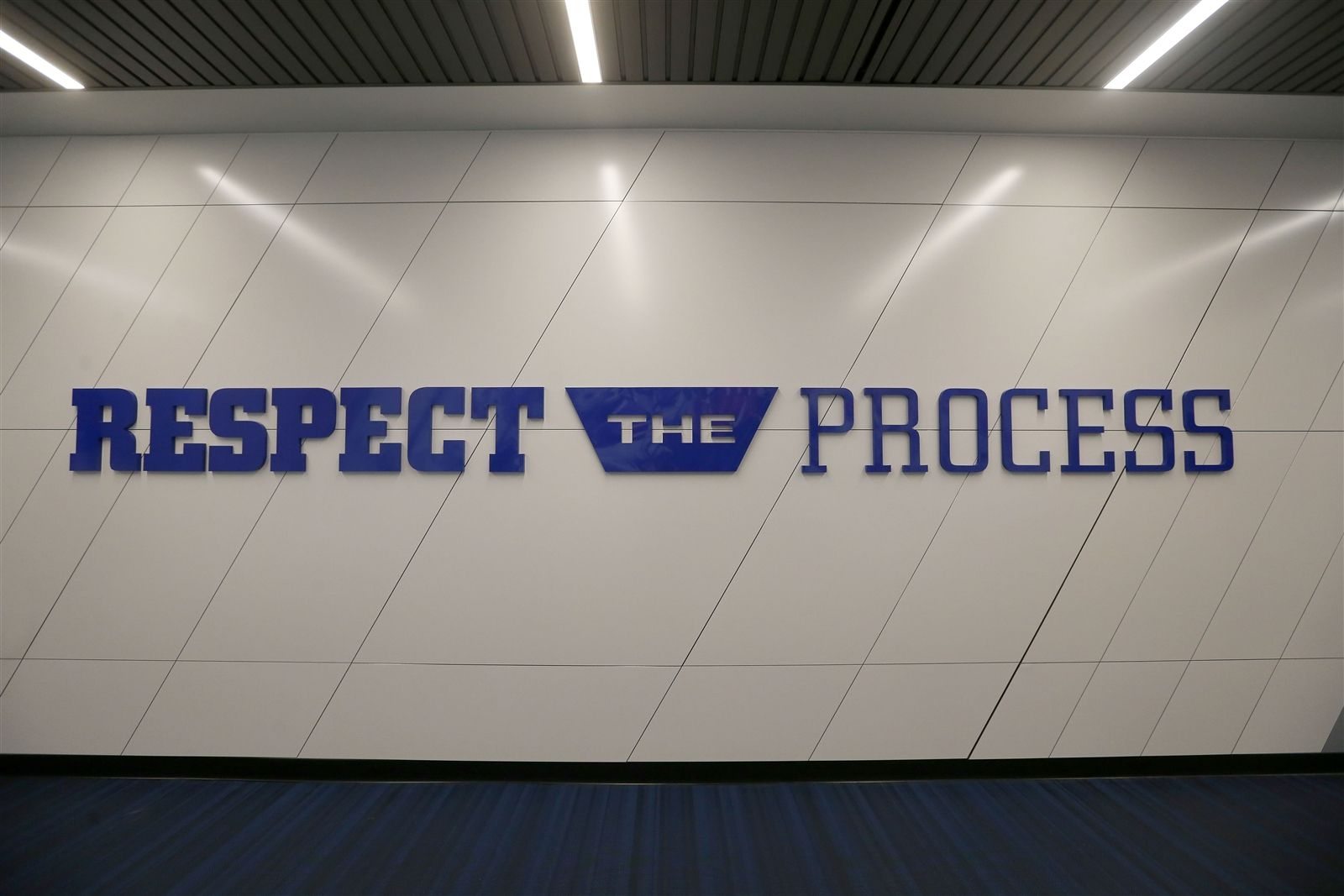 The hallway leading to the new performance center features one of coach Sean McDermott's favorite phrases.
