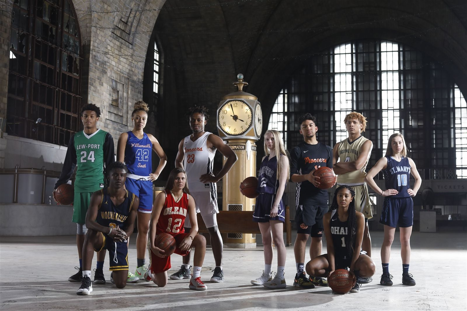 The All-WNY Basketball First Team: from left, Roddy Gayle (Lew-Port,) Willie Lightfoot (Niagara Falls,) Amari DeBerry (Williamsville South,) Sara Pfeiffer (Olean,) Quentin Nnagbo (Park,) Dani Haskell (Franklinville,) Noah Hutchins (Park,) Angel Parker (Cardinal O'Hara,) Justin Hemphill (Cardinal O'Hara) and Shay Ciezki (St. Mary's of Lancaster) at the Central Terminal.