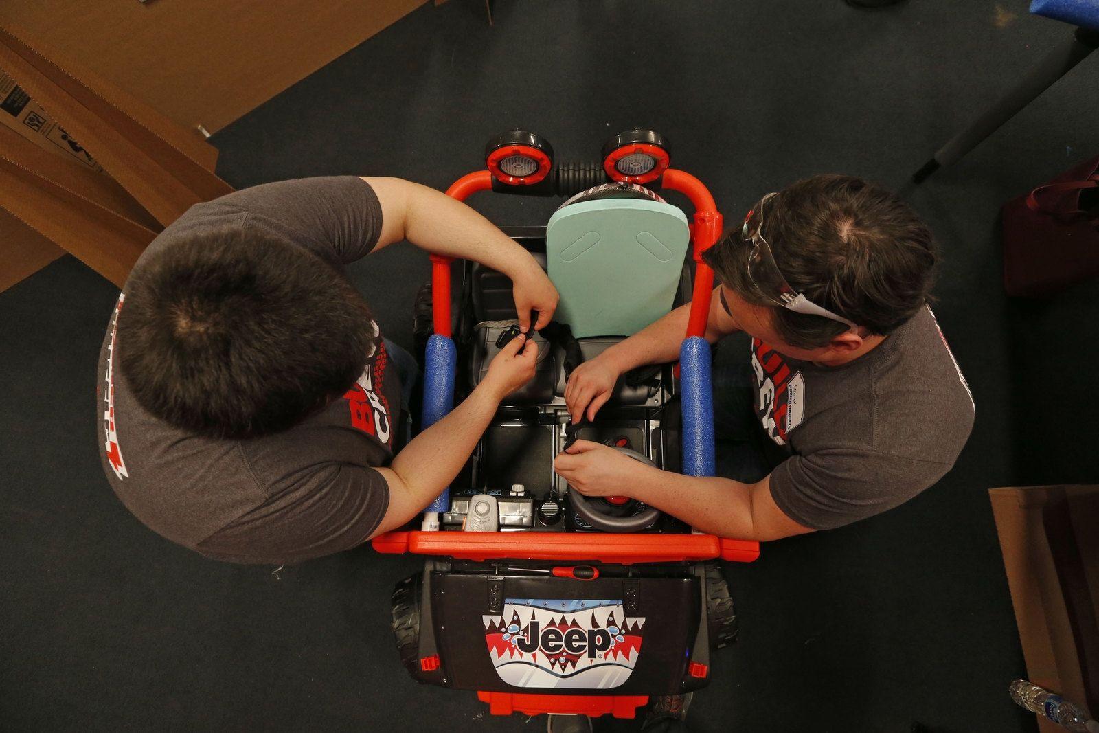 Students Noah Demetri, left, and Connor Bowman go through their final checklist before testing their car.