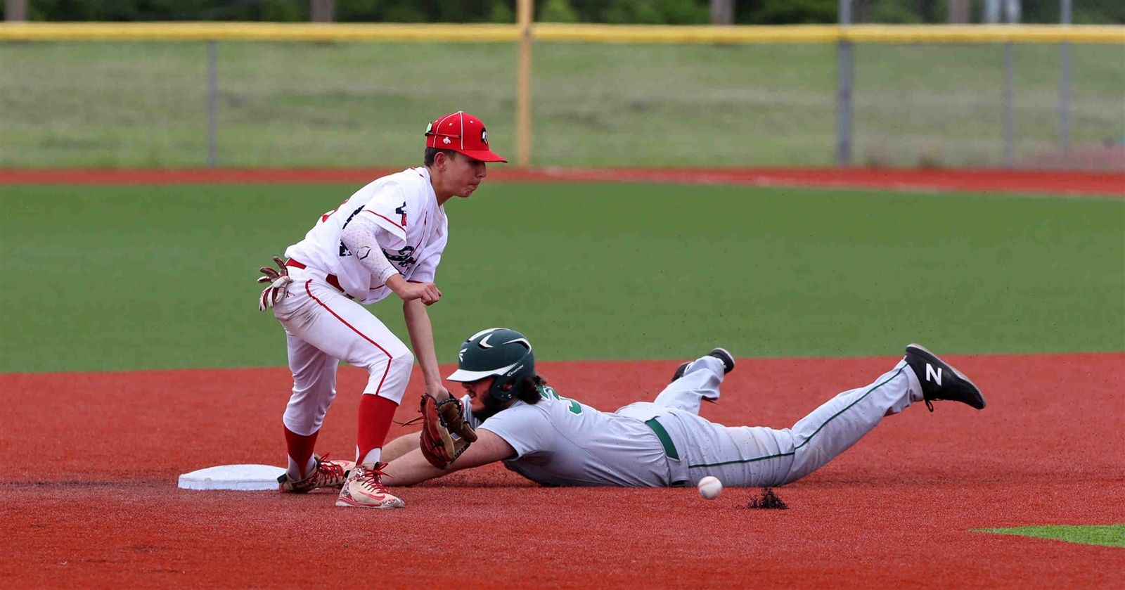 Lake Shore's Nick Wilson slides into 2nd as Iroquois' Tyler Birdd waits for the ball  in the 5th inning of the Class A2 baseball final at Niagara Falls High School on Thursday, May 30, 2019.