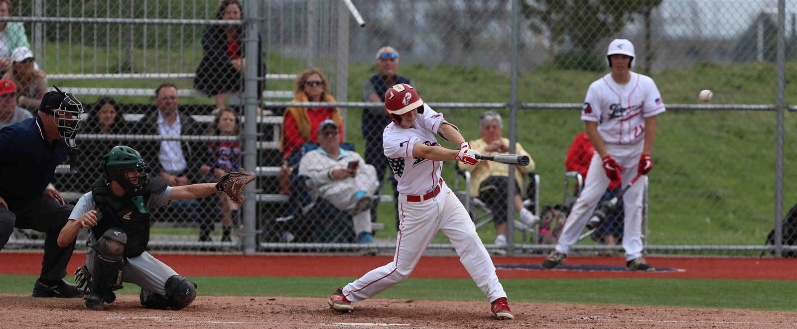 Iroquois' Owen Hovey hits the ball in the sixth inning and brings in the single RBI of the game.