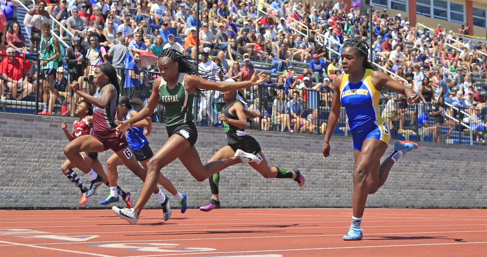 Kahniya James finishes third in the Division 1 Girls 100 Meter Dash at the NYSPHSAA Track & Field Championships at Middletown high school on Saturday, June 8, 2019.