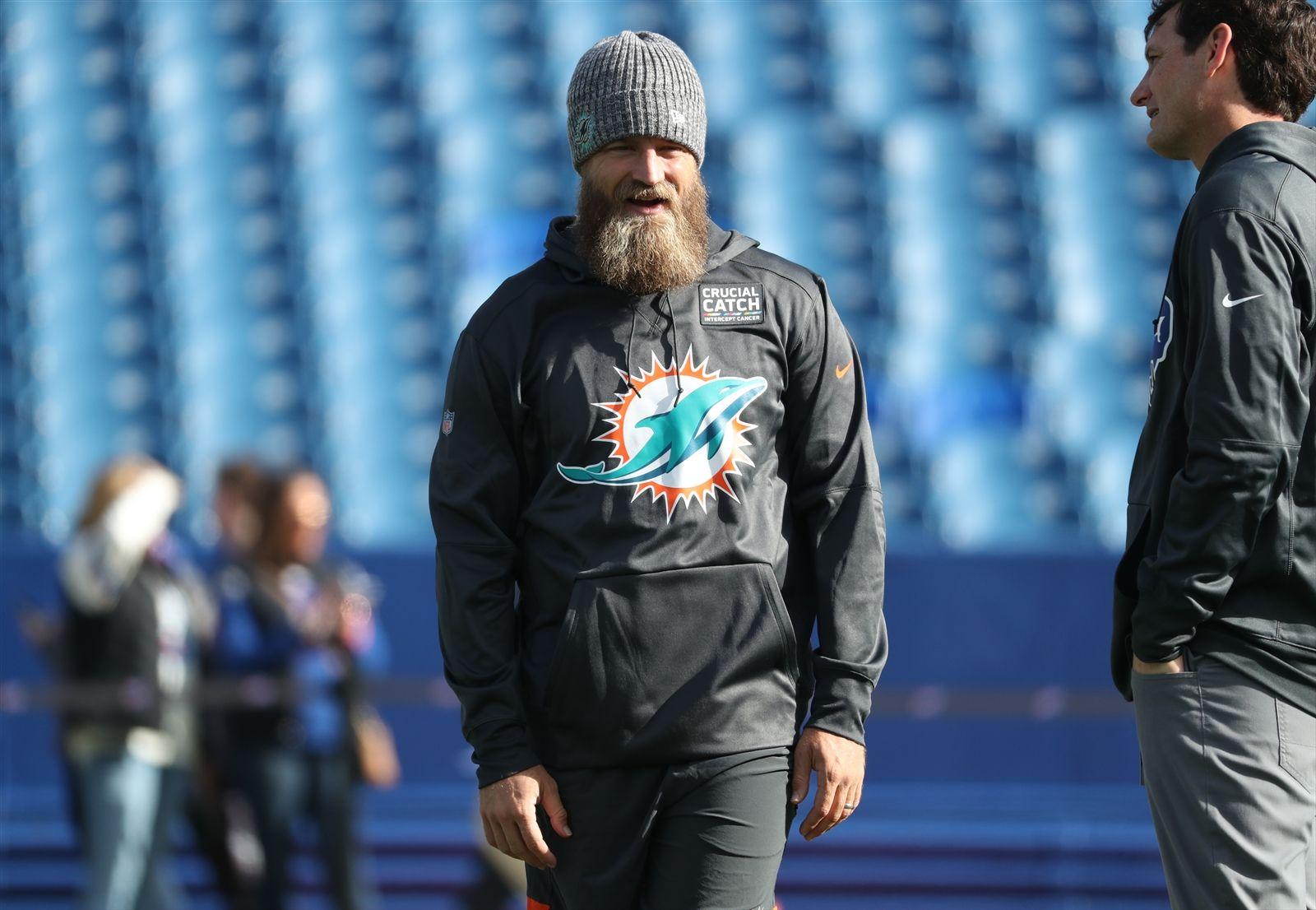 Miami Dolphins quarterback Ryan Fitzpatrick (14) walks around the field during pregame warmups.