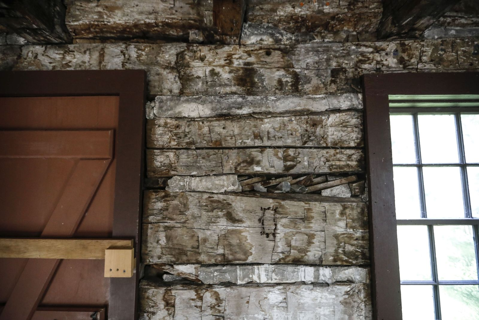 Inside the Schmitt Log House, the unfinished walls reveal the 19th century log house style of construction.
