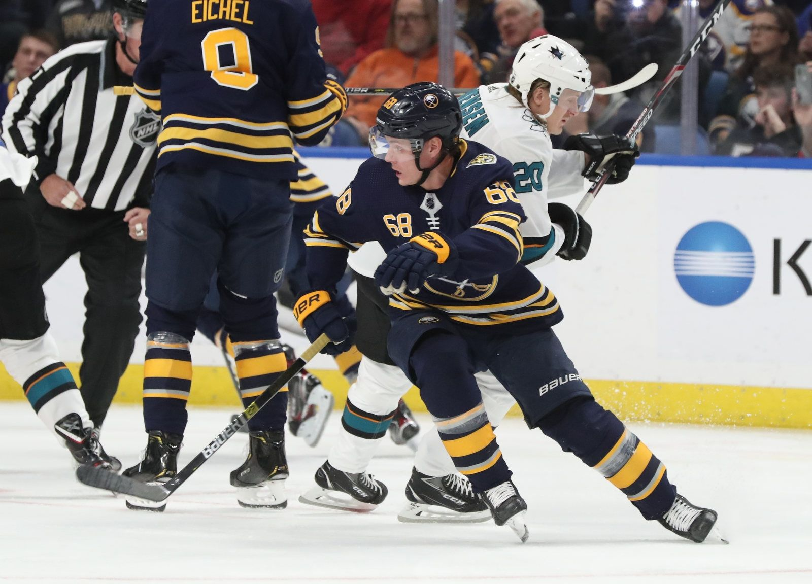 Buffalo Sabres right wing Victor Olofsson (68) battles San Jose Sharks left wing Marcus Sorensen (20) for the puck during the first period.