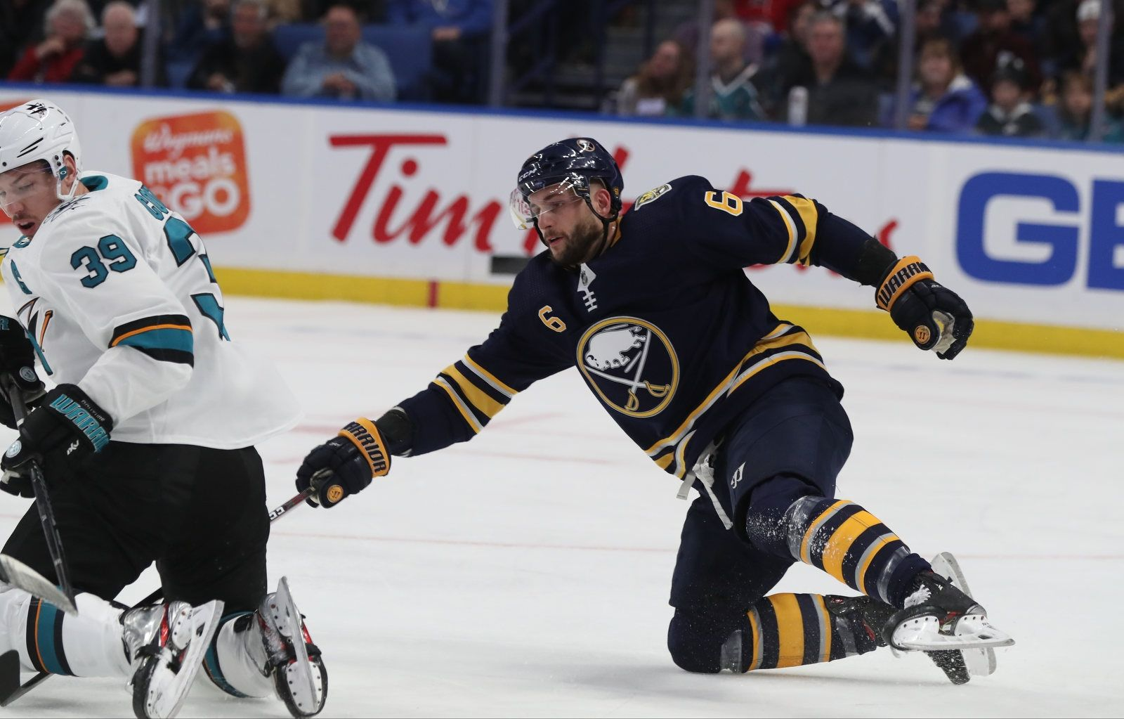 Buffalo Sabres defenseman Marco Scandella (6) battles San Jose Sharks center Logan Couture (39) for the puck in the first period.