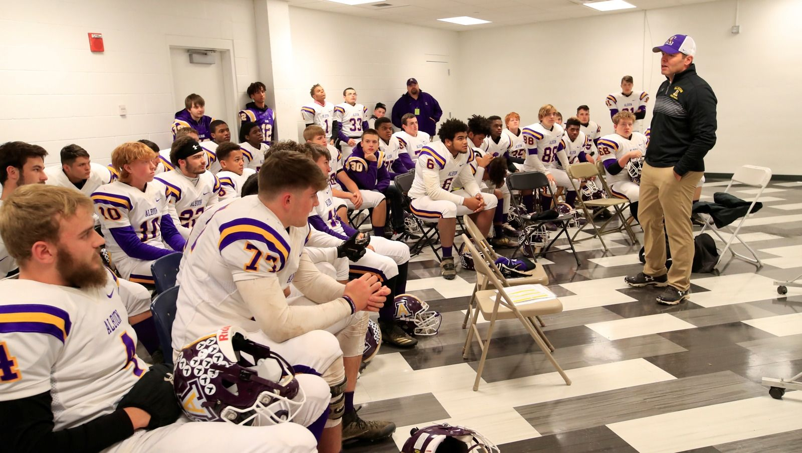 Albion Purple Eagles caoch Adam Krenning speaks to his team.