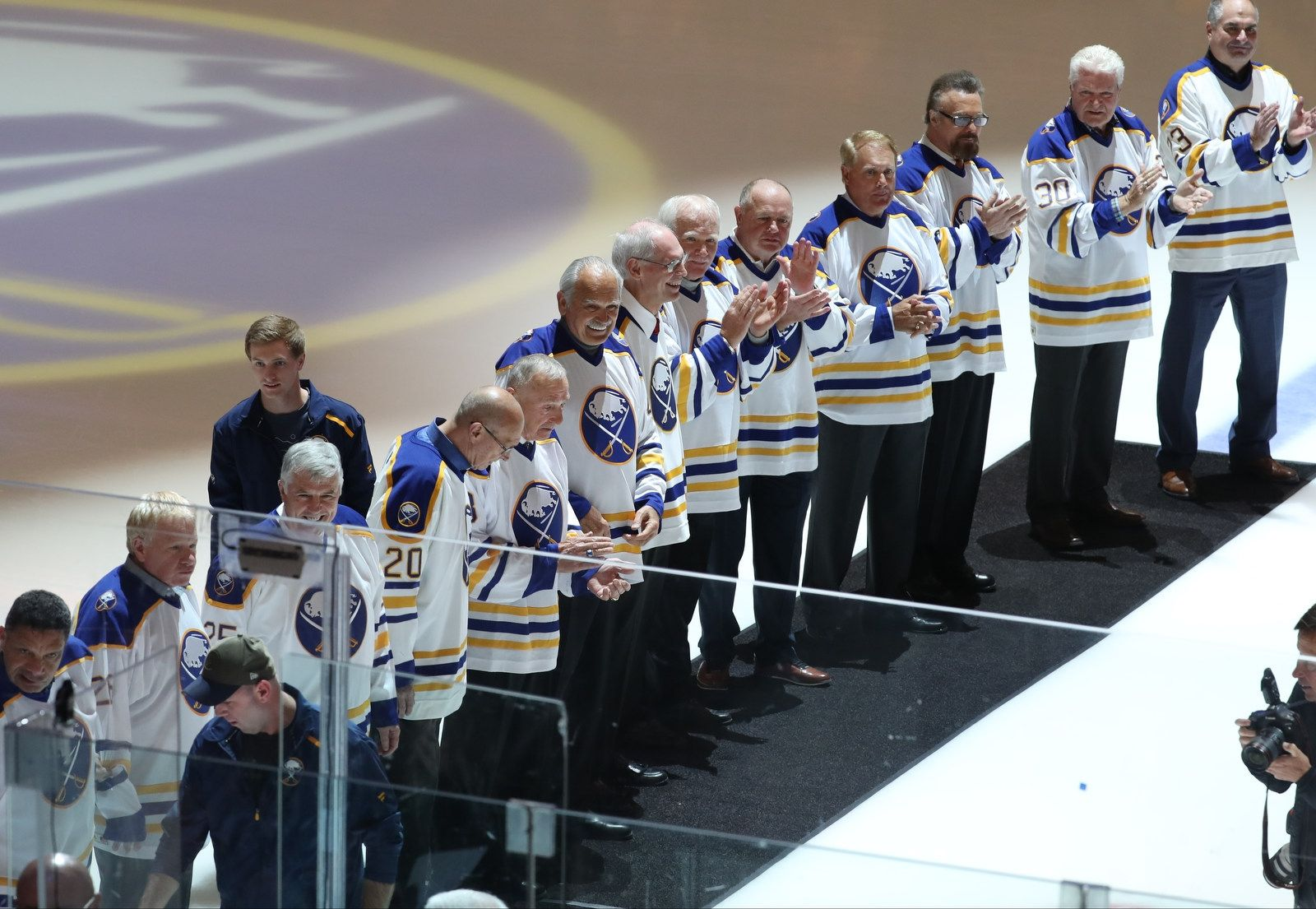 Over 20 alumni helped celebrate the first decade in team history before the start of the game.