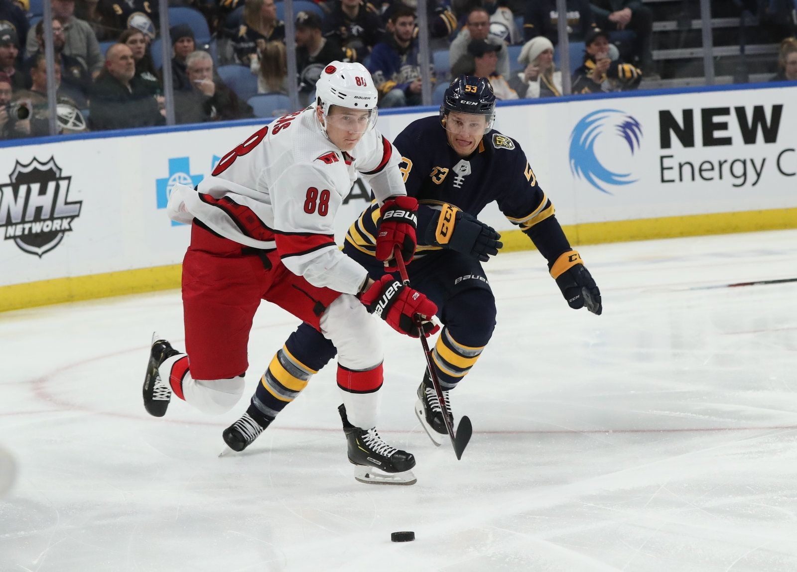 Buffalo Sabres center Jeff Skinner (53) skates without a stick against Carolina Hurricanes center Martin Necas (88) in the first period.