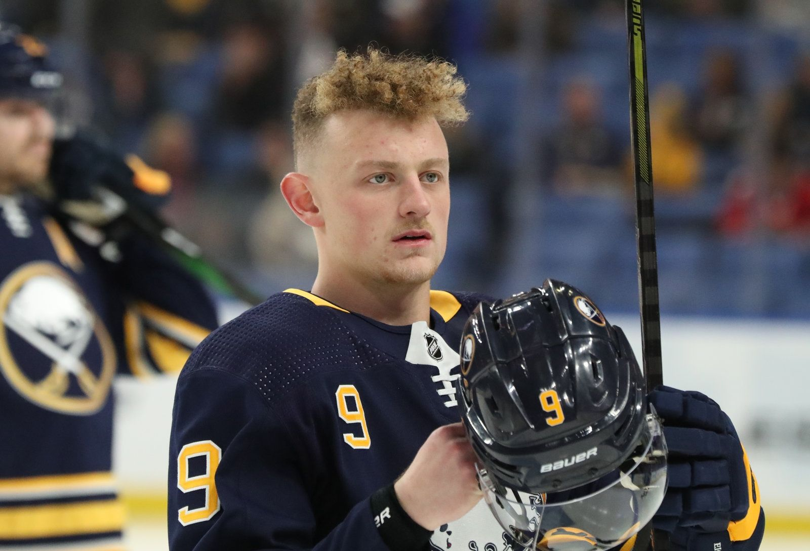 Buffalo Sabres center Jack Eichel (9) skates to the bench before the start of the game.