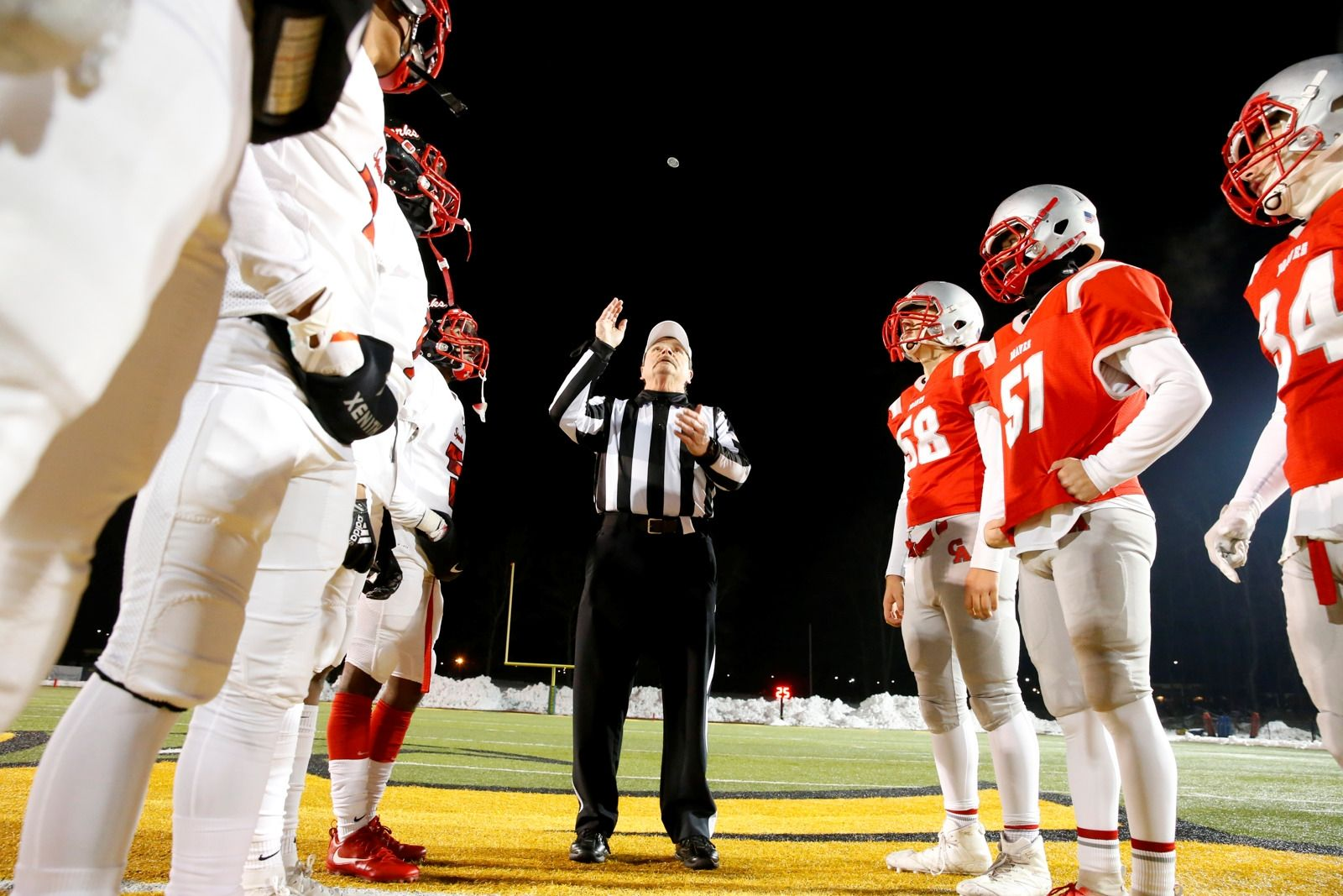 Al Fuller flips the coin prior to South Park and Canandaigua Academy Class A Far West Regional game at SUNY Brockport on Friday, Nov. 15, 2019.