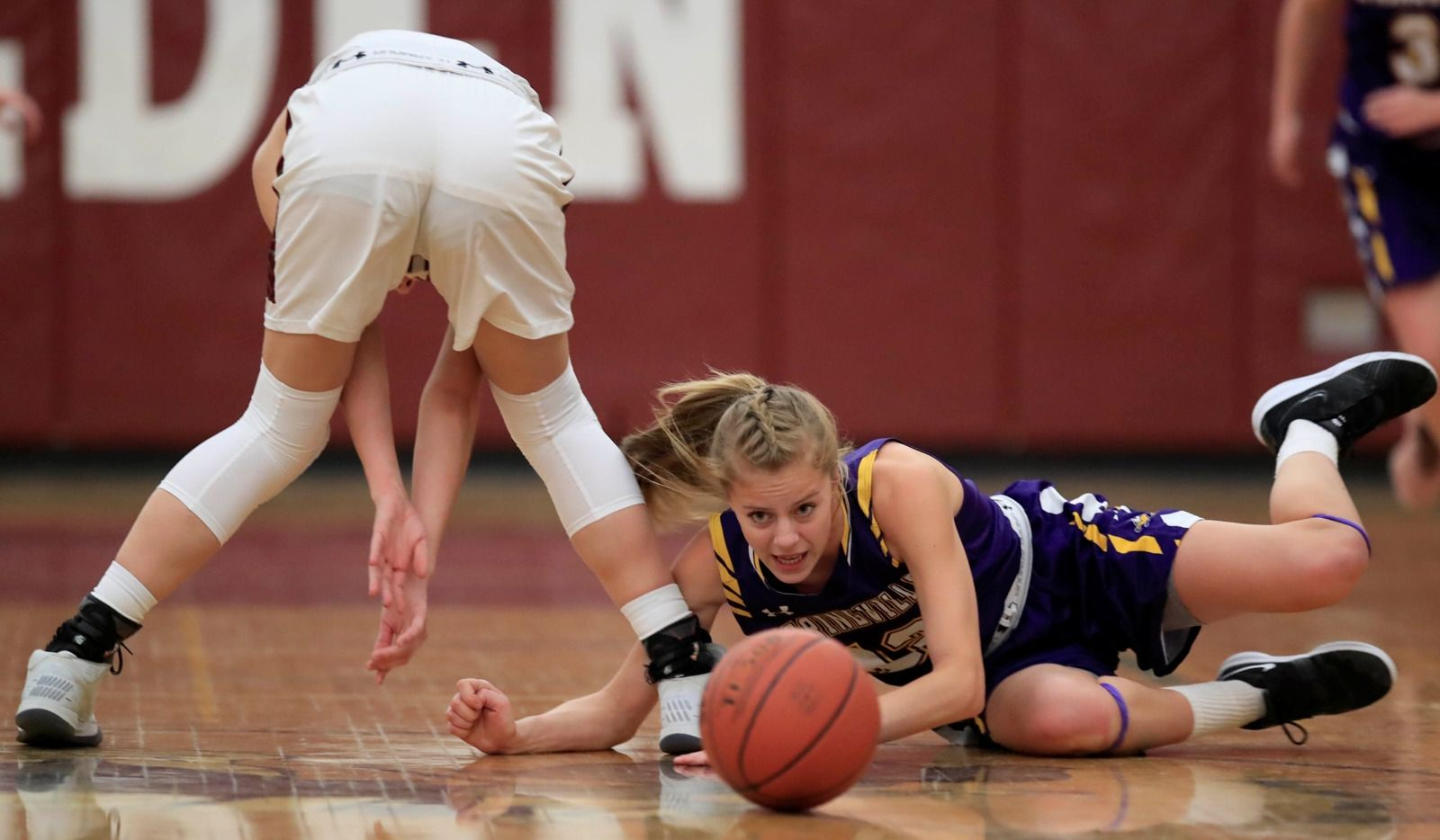 Springville's Kelsey Zabawa chases down a loose ball against Eden during the first half at Eden High School on Jan. 7, 2019.