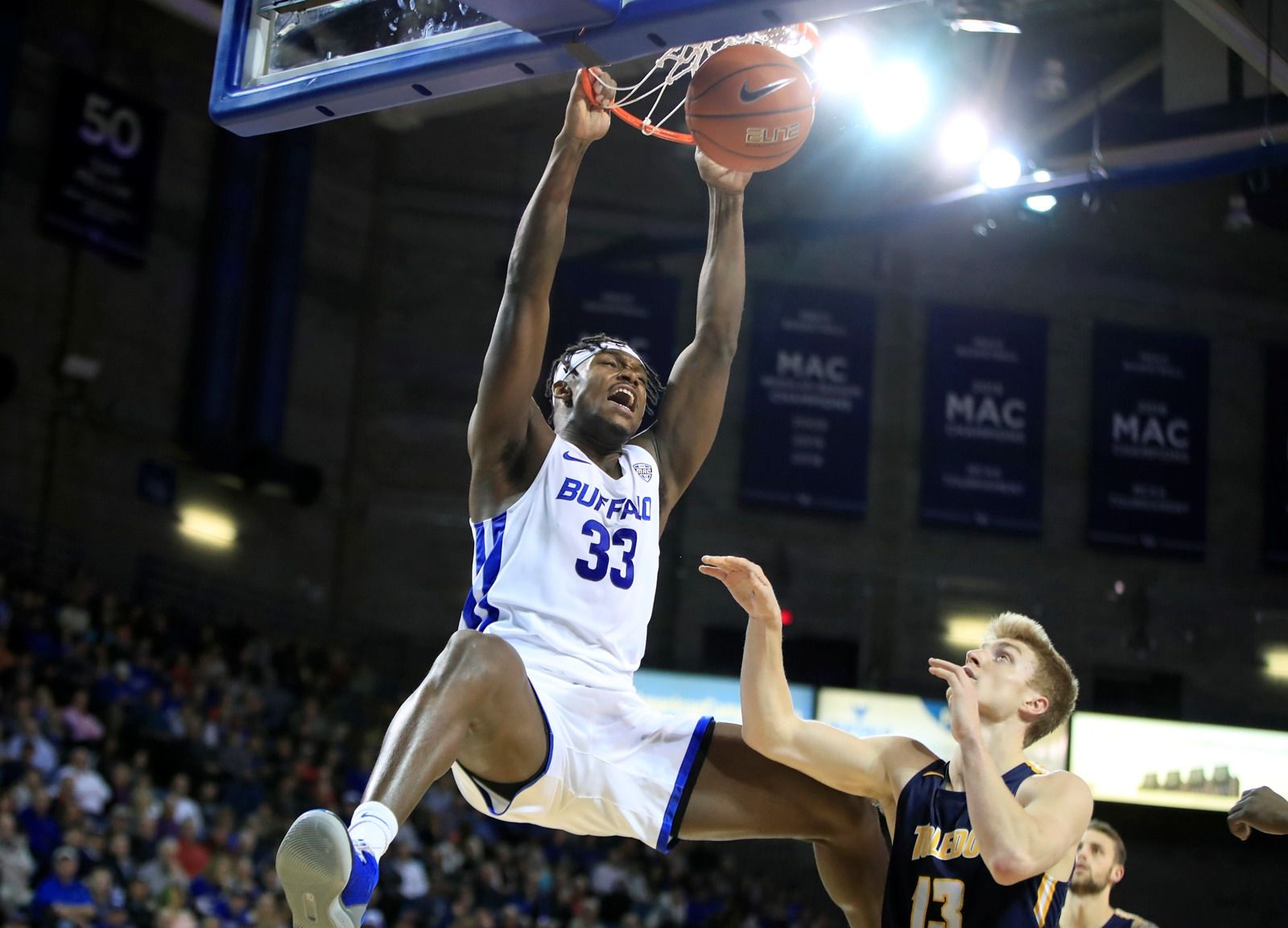 Buffalo forward Nick Perkins dunks against Toledo during the first half at Alumni Arena on Tuesday, Jan. 8, 2019.