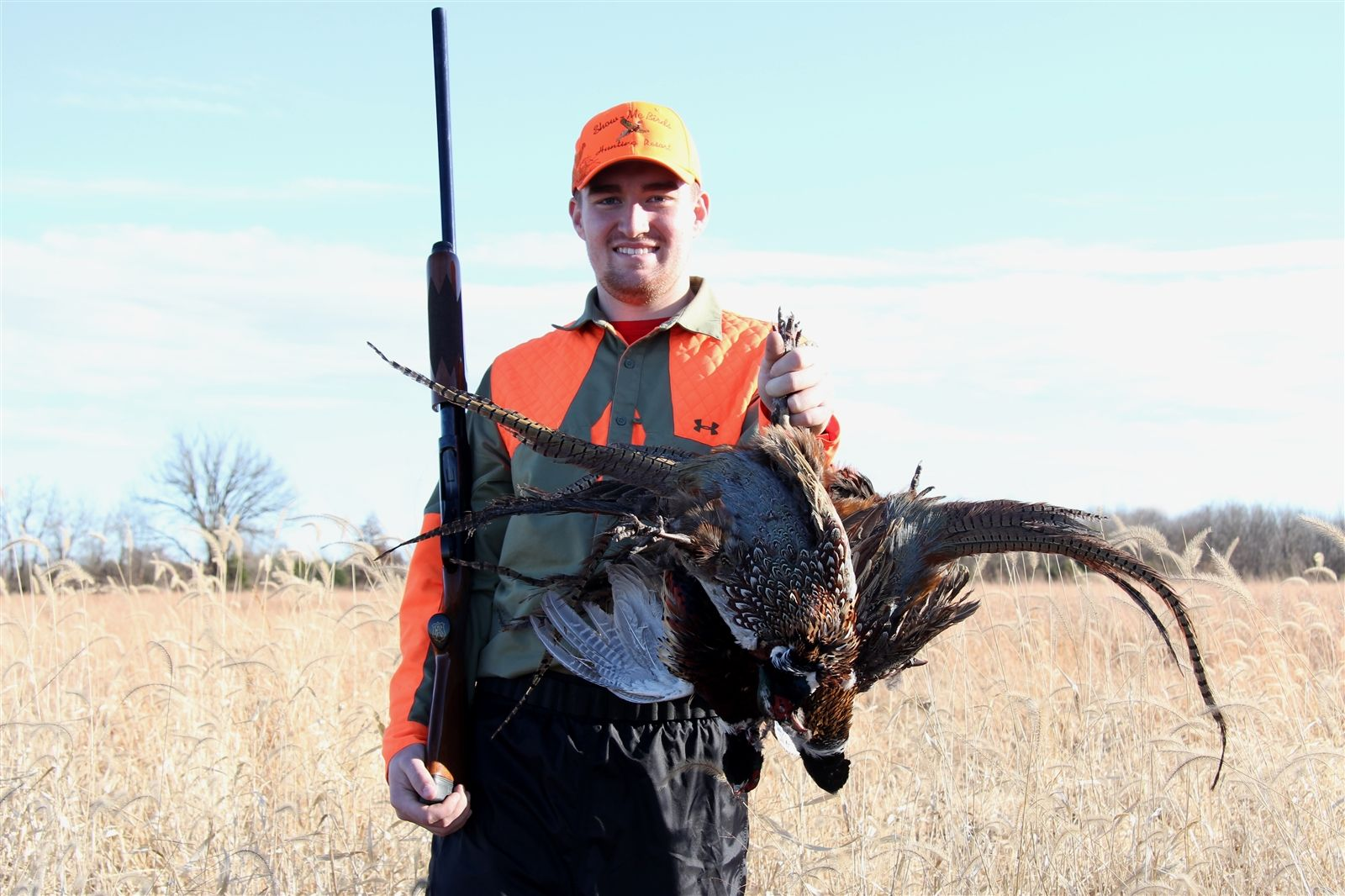 Ryan Phillips of Pendleton, N.Y., chasing roosters in South Kansas over Thanksgiving break.