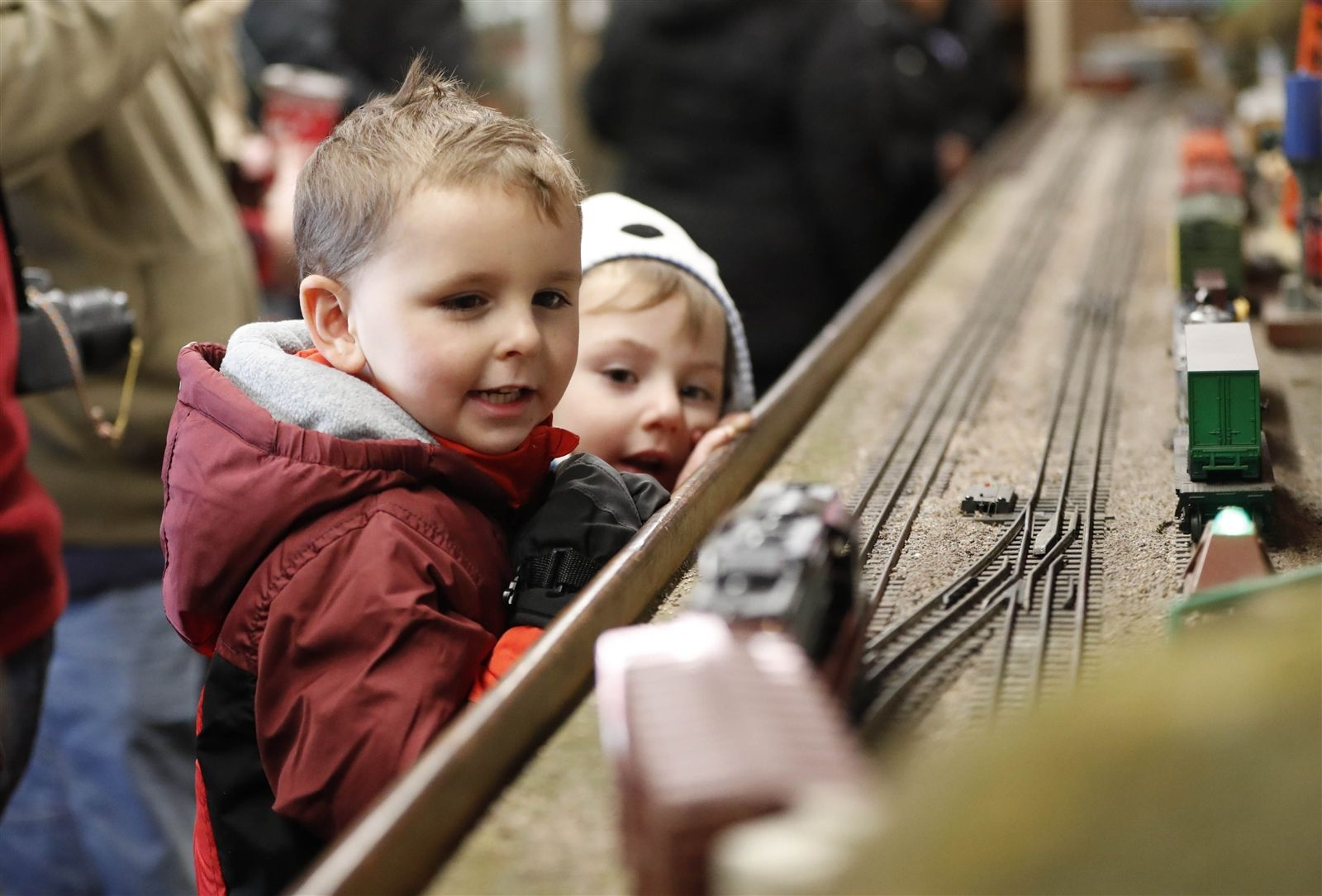 Matthew Jackson, 5, left, and Zak Ion, 3, watches the trains in an operating train exhibit at Artcraft Toy Trains before Santa arrives.