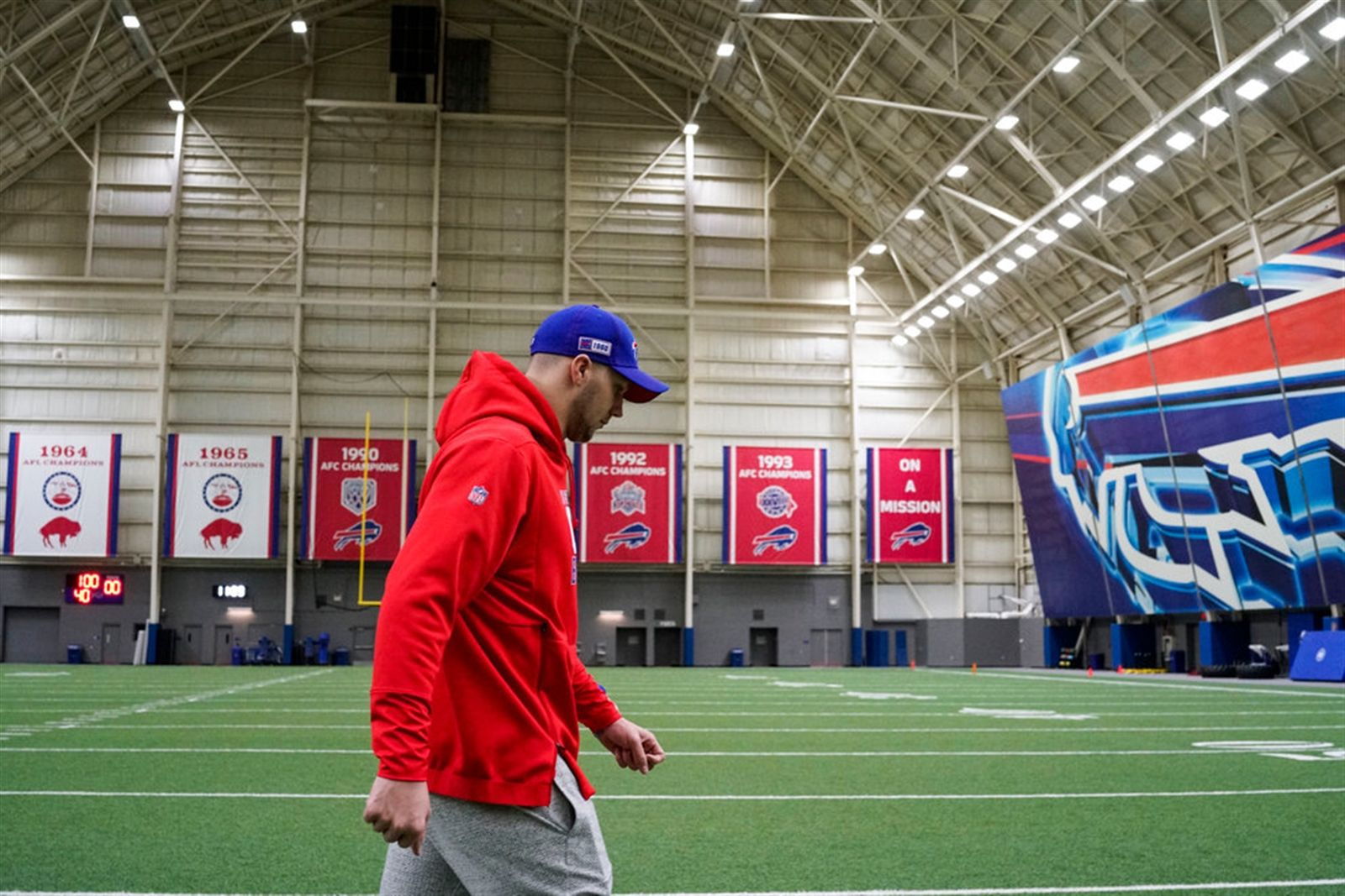 Buffalo Bills quarterback Josh Allen walks across the field in the fieldhouse after talking to the media one last time.