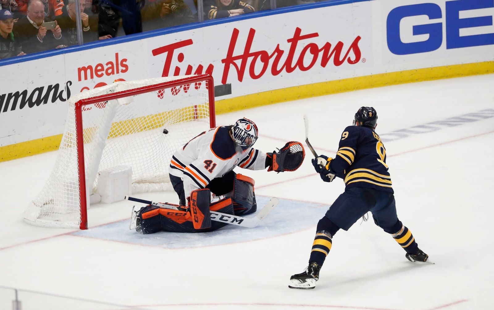Buffalo Sabres captain Jack Eichel (9) scores on a penalty shot on Edmonton Oilers goalie Mike Smith in overtime to give the Sabres a 3-2 victory.