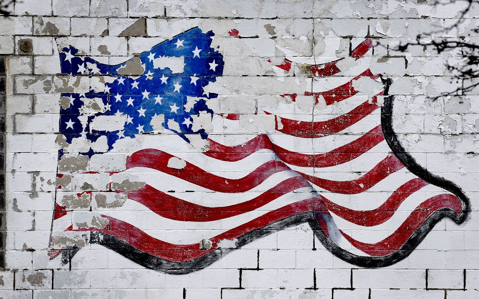 Day 17: Jan. 17, 2020 - Decades of exposure to the elements has faded the U.S. flag painted on the side wall of the old Metro Community News location on French Road in Cheektowaga.