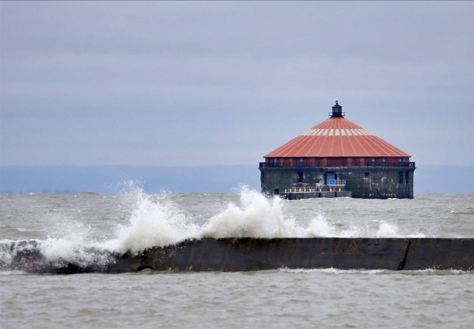 Waves crash against the breakwall near the water intake building as seen from LaSalle Park in Buffalo on  Sunday, Jan. 12, 2020.