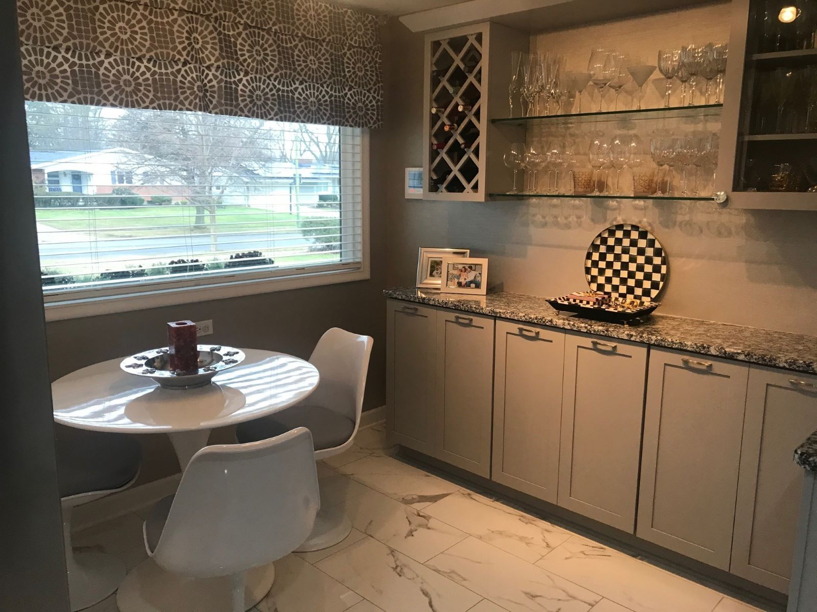 Nancy A. Gaglione added storage for glassware and wine bottles in the eating area.