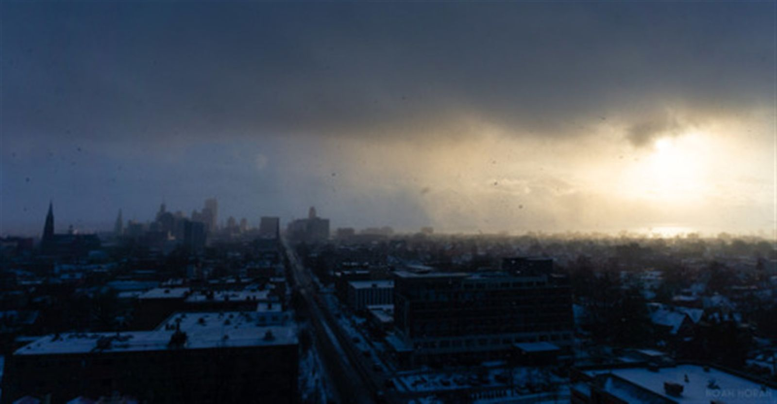 Sunlight breaks through the clouds over a snow-covered Buffalo on Jan. 19, 2020.